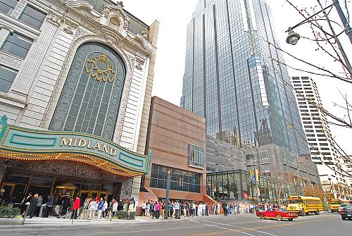 Lines of students and the just a few of the busses they came in on entering the Midland Theater in downtown Kansas City, MO to see the Alvin Ailey Dance Company special performance for schools Nov 2008