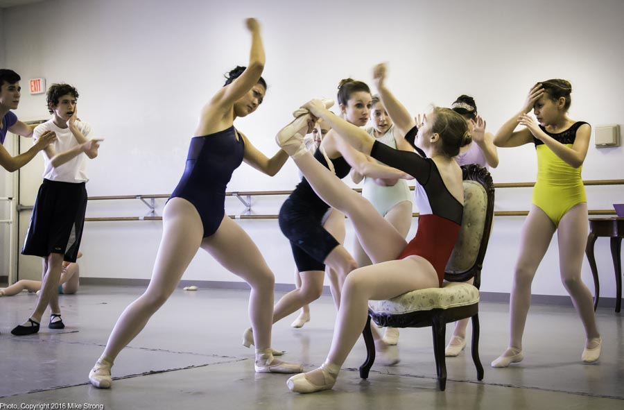 Anne Marie Dahms in chair and Cassie Wang (left pounding on the shoe) (as the evil step-sisters) trying to fit the shoe that doesn't fit. Jennifer Tierney (behind) as step mother (who was fairy godmother for Madison Ballet)