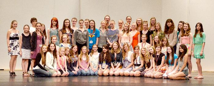 A number of the Kansas City Ballet School's Summer Intensive (2011) students line up on stage in White Recital Hall for a photograph. Husband and wife dancers, Amanda McKerrow and John Gardner are in the center back.