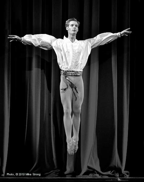 Gabriel Davidsson in front of the curtain as the jealous Russian dancer who orders a hit on the hoofer during the show in a show - Slaughter on Tenth Avenue by George Balanchine - Kansas City Ballet  October 2010 - photo copyright Mike Strong - ballet copyright Balanchine Foundation