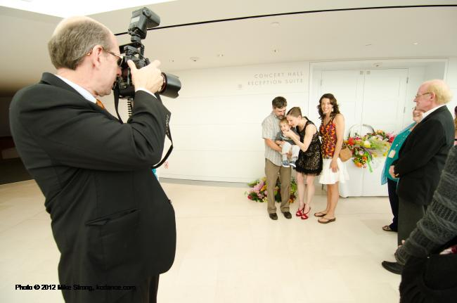 Larry Levenson photographs the reception line for Kimberly - retirement reception for Kimberly Cowen