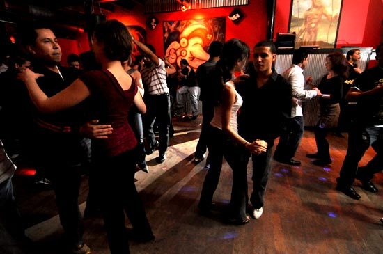 Salsa dancers on a thursday at Madrigal (1627 Oak, KCMO) hosted by Howard Carney - Photo, Mike Strong, www.kcdance.com