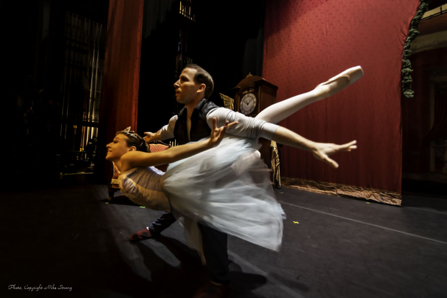 Pre-show, behind the curtain, Julia Walewicz and Ben Rabe practicing a fish position for Snow Queen and King
