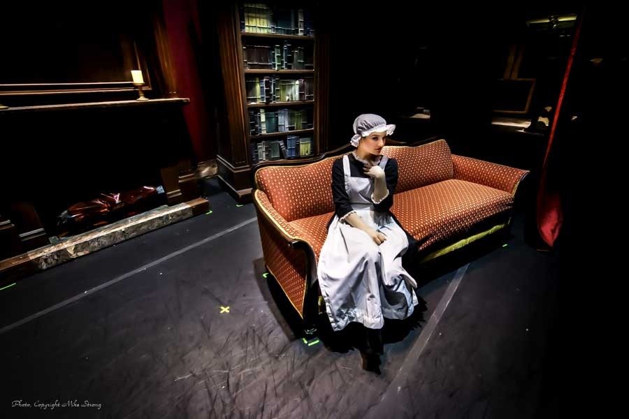 "The incredibly famous and enigmatic ""Woman on a Couch"" image - Annie Cook in maid costume, preshow behind the curtain."