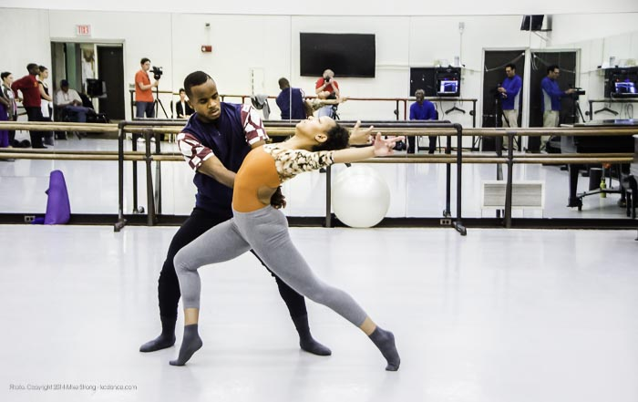 In-studio rehearsal - Maleek Washington and Miyesha McGriff in Heart Thieves by Robert Moses for Wylliams-Henry Contemporary Dance Co. Robert Moses can be seen in the background mirror in seated, blue shirt, just right of center.
