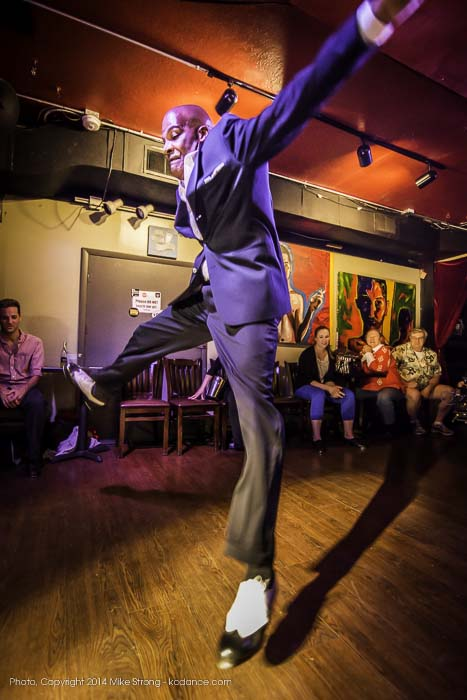 Lonnie McFadden during a tap jam at the Uptown Arts Bar, from in close with ultra-wide angle lens